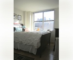 UPPER EASTSIDE/HIGH-FLOOR TWO BEDROOM/ROOFTOP SUNDECK, GARAGE, AND GARDEN
