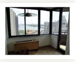 MAGICAL PANORAMIC VIEWS OF THE EAST RIVER TWO BEDROOM ONE AND A HALF BATHROOM CONDO WITH A BALCONY